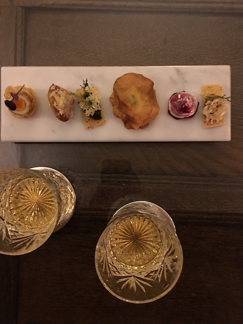 Chef Brodie's exquisite canapés paired with a peaty Llangoed Hall Special Whiskey