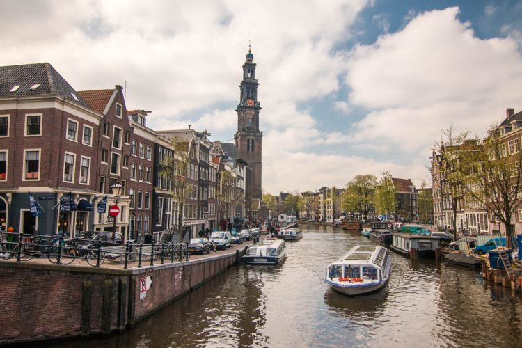 Canal cruising Amsterdam 750x500 - A City Break in Amsterdam: Things to See, Do, and Eat