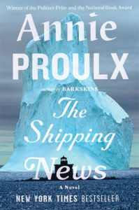 Front cover of Annie Proulx's The Shipping News featuring a giant blue, white iceberg and a silouette of a ship.