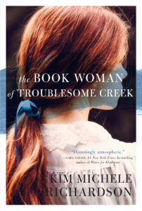 Auburn-haired woman looking off the side of the book cover with a stroke of blueberry blue across her face.