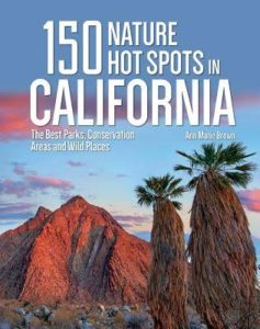 Front cover image of 150 Nature Hot Spots in California with red mountains and interesting trees