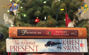 Image of two books: Karen Swan's The Perfect Present and Richard Paul Evans' Promise Me in front of a Christams Tree