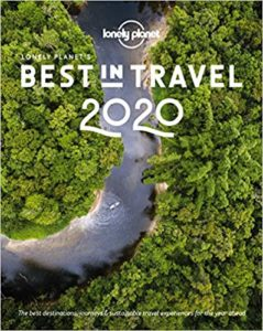 Front cover image of Lonely Planet's best places to travel in 2020 with a kayak sailing down a river